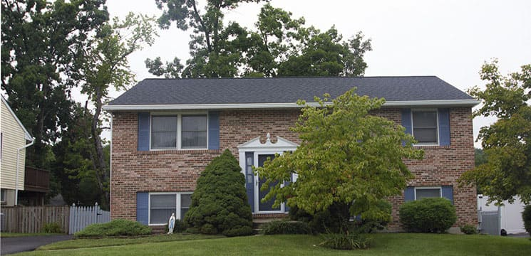 front view of brick house showing new roofing