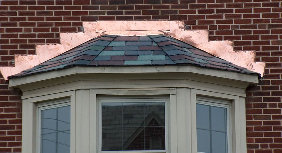 close up of outward window roofing in progress