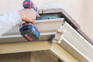 individual providing gutter repair and replacement in Baltimore MD