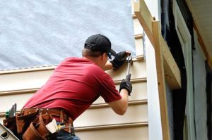 a contractor working on Siding Installation & Replacement