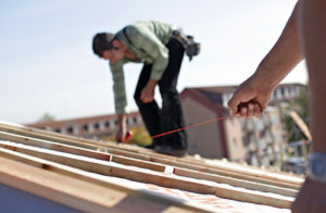 man installs a roof in howard county