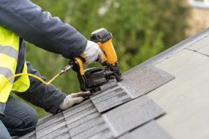 man installs a roof in rockville maryland