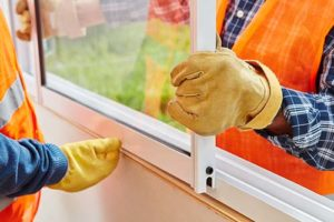 men installing a window in Baltimore county